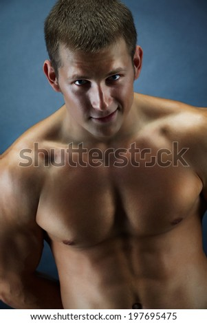 Image of handsome shirtless man looking at camera over dark background - stock photo