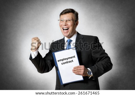 Image of happy business man with fist in dark suit and with employment contract - stock photo
