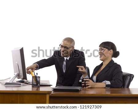 Image of happy business people pointing on the computer against white background - stock photo