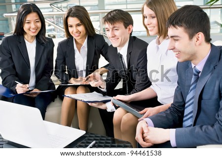 Image of happy business people working at meeting