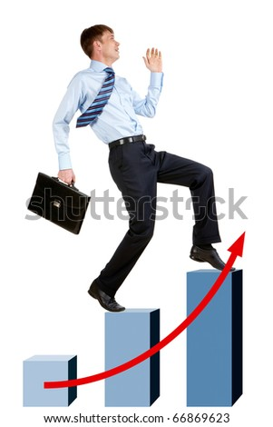 Image of happy businessman running upstairs on chart column tops