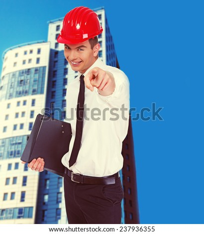 Image of happy businessman who is pointing on someone with his finger - stock photo