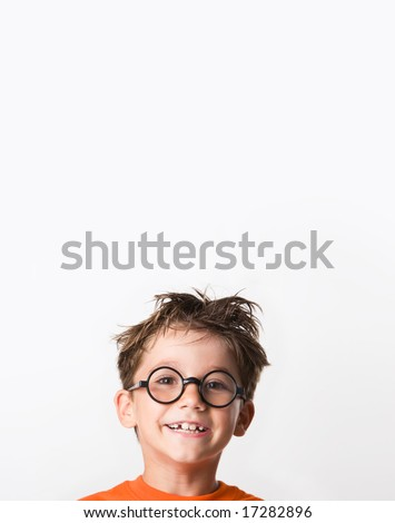 Image of happy child with tousled hair looking at camera with smile - stock photo