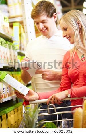 Image of happy couple choosing porridge - stock photo