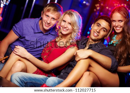 Image of happy couples at party in the night club