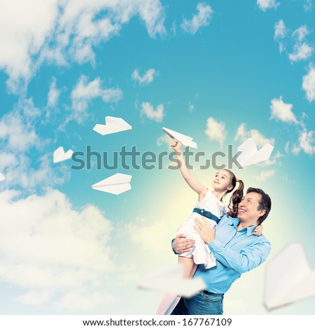 Image of happy father holding on hands daughter - stock photo