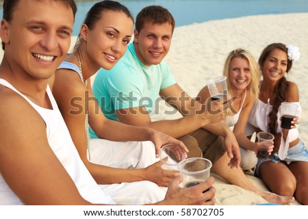 Image of happy friends with drinks having fun at beach party - stock photo