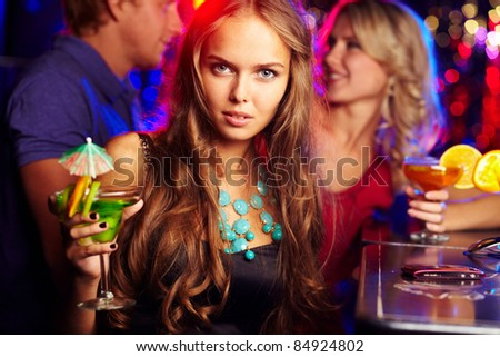 Image of happy girl looking at camera with her friend behind - stock photo