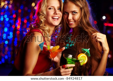 Image of happy girls looking at camera at party - stock photo