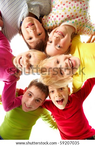 Image of happy kids embracing and laughing in circle - stock photo