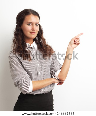 Image of happy smiling beautiful young businesswoman showing copyspace over white - stock photo