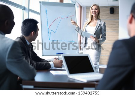 Image of happy teacher talking to business people at seminar - stock photo