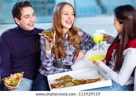 Image of happy teenage friends eating pizza together - stock photo