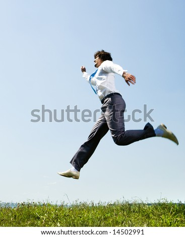 Image of hastening businessman running to business meeting