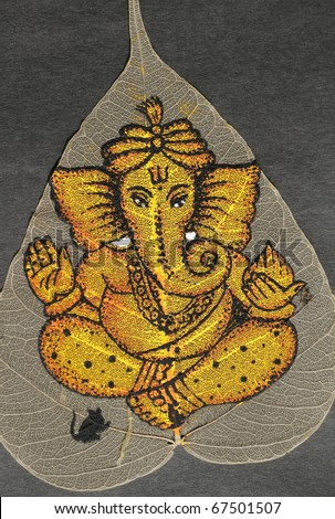 image of hindu deity Ganesha painted on leaf - stock photo