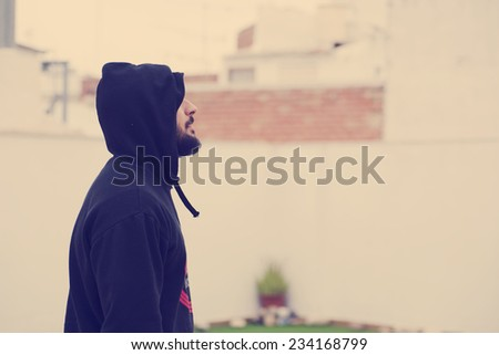 Image of hipster profile trendy man with hood. - stock photo