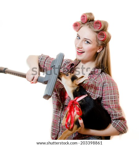 image of holding cute puppy and vacuum cleaner beautiful pinup charming girl with blue eyes, curlers and red lips having fun posing happy smiling and looking at camera on white copy space background - stock photo