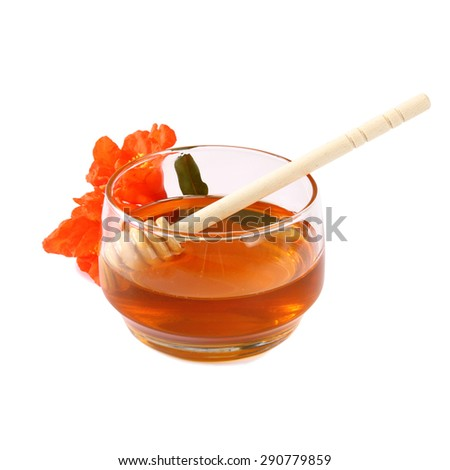 image of honey glass jar. rosh hashanah (jewesh holiday) concept.  traditional holiday symbols. isolated on white