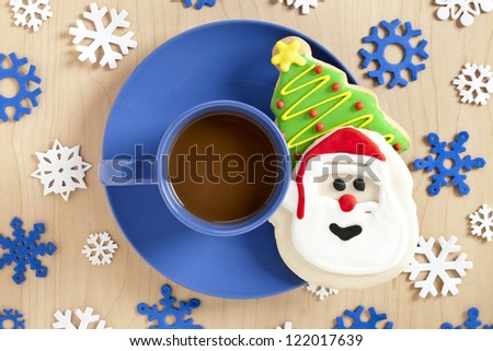 Image of hot chocolate and christmas cookies on blue plate - stock photo