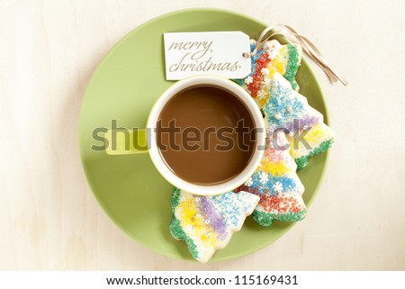 Image of hot chocolate in a cup in green saucer with christmas cookies isolated on a background - stock photo