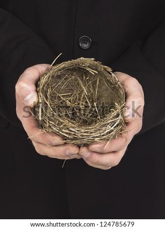 Image of human hand holding bird nest - stock photo