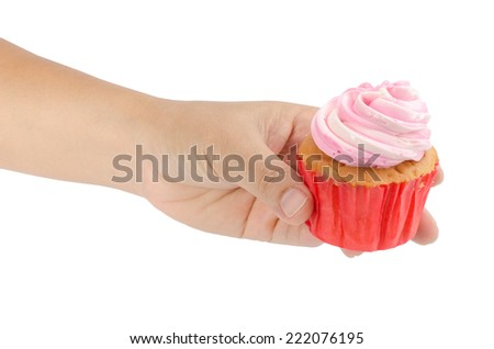 Image of human hand holding cup cake isolate on white background - stock photo