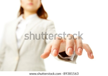 Image of human hand keeping palm down on background of female - stock photo