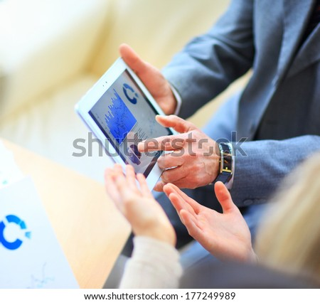 Image of human hand with pointer over business document in office - stock photo