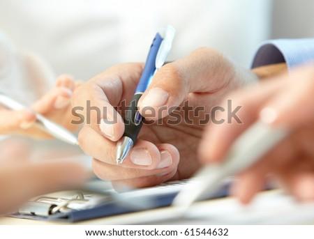 Image of human hand writing at seminar or conference - stock photo