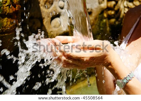 Image of human hands catching water splashes - stock photo