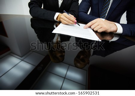 Image of human hands during reading contract - stock photo
