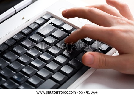 Image of human hands pressing keys of laptop - stock photo