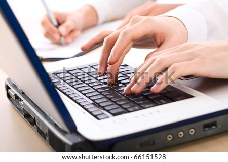 Image of human hands pressing keys of laptop - stock photo