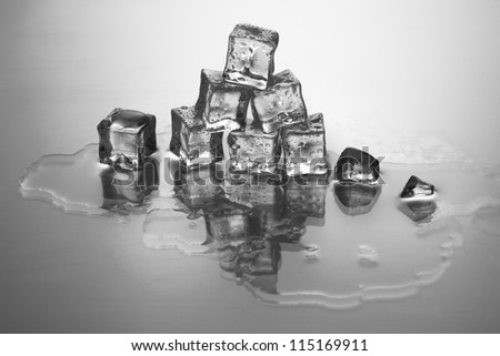 Image of ice cubes isolated on a grey background - stock photo