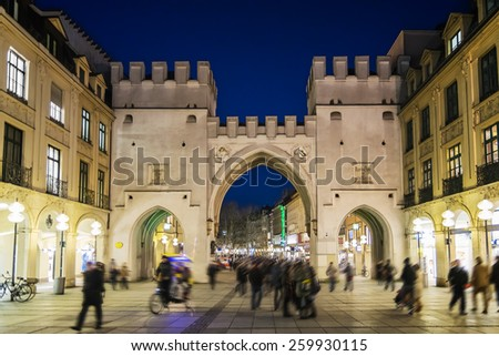 Image of illuminated gate named Karlstor with people in Munich, Bavaria, Germany - stock photo
