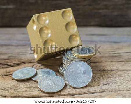 Image of investment and currency exchange trading risk and return concept. Dices and assorted of coins - stock photo