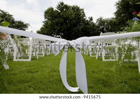 image of isle runner ribbon at an outdoor wedding - stock photo