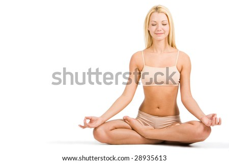 Image of isolated woman sitting in pose of lotus with closed eyes on white background - stock photo