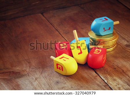 image of jewish holiday Hanukkah and wooden dreidels (spinning top).  - stock photo