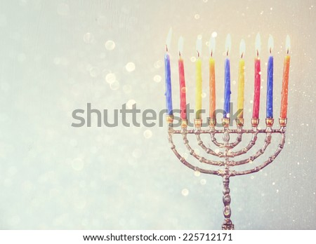 Image of jewish holiday Hanukkah background with menorah Burning candles over aqua glitter background - stock photo