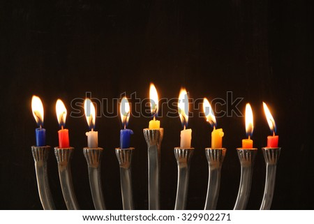 Image of jewish holiday Hanukkah background with menorah (traditional candelabra) and Burning candles  - stock photo