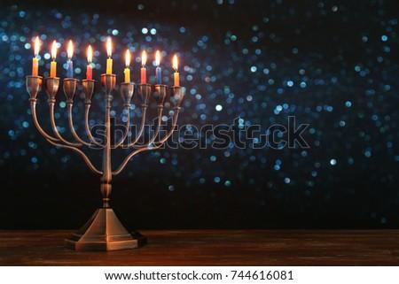 image of jewish holiday hanukkah background with menorah traditional candelabra and burning candles
