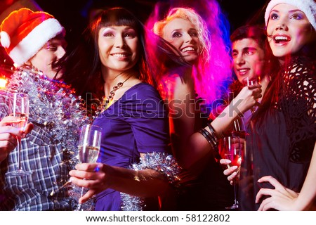 Image of joyful friends having fun at disco in night club at party - stock photo