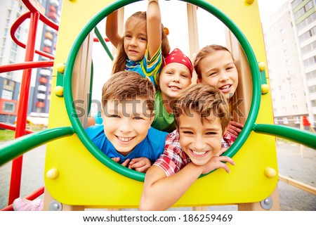 Image of joyful friends having fun on playground outdoors  - stock photo