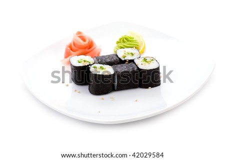 Image of kappa hosomaki sushi with pickled ginger and wasabi on a plate