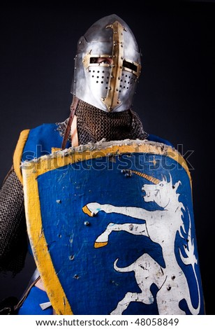 Image of knight holding his shield - stock photo