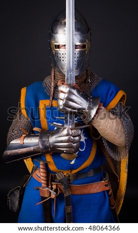 Image of knight in combat position - stock photo