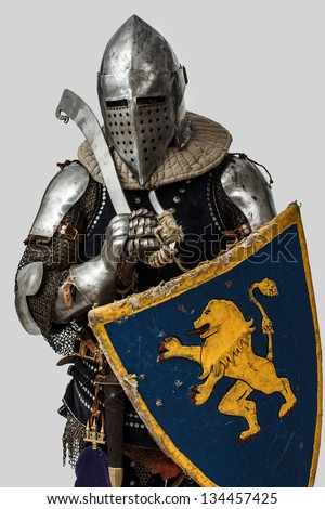 Image of knight with weapon and shield