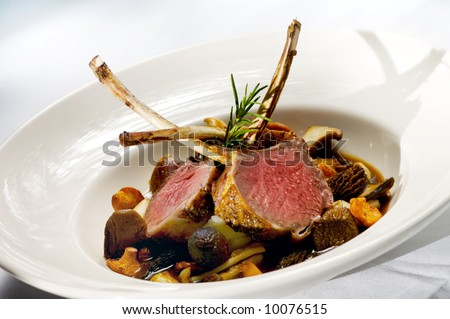 Image of lamb chops on a bed of vegetables - stock photo