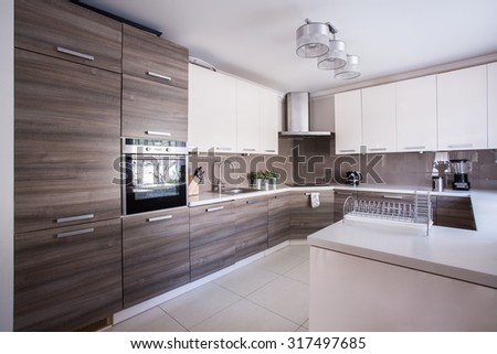 Image of large luxury kitchen furnished in modern design - stock photo